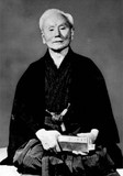 """Funakoshi"". Licensed under Public Domain via Wikimedia Commons - http://commons.wikimedia.org/wiki/File:Funakoshi.jpg#mediaviewer/File:Funakoshi.jpg"